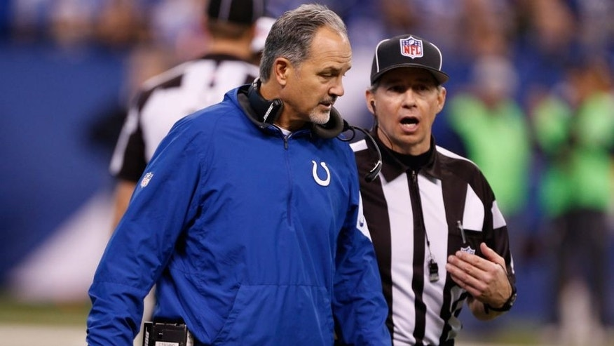 Dec 20, 2015; Indianapolis, IN, USA; Indianapolis Colts coach Chuck Pagano (L) questions a call against the Houston Texans at Lucas Oil Stadium. The Texans won 16-10. Mandatory Credit: Brian Spurlock-USA TODAY Sports