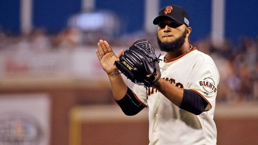 San Francisco Giants relief pitcher Yusmeiro Petit celebrates after striking out St. Louis Cardinals' Matt Carpenter during the fourth inning of Game 4 of the National League baseball championship series Wednesday, Oct. 15, 2014, in San Francisco. (AP Photo/Jeff Roberson)