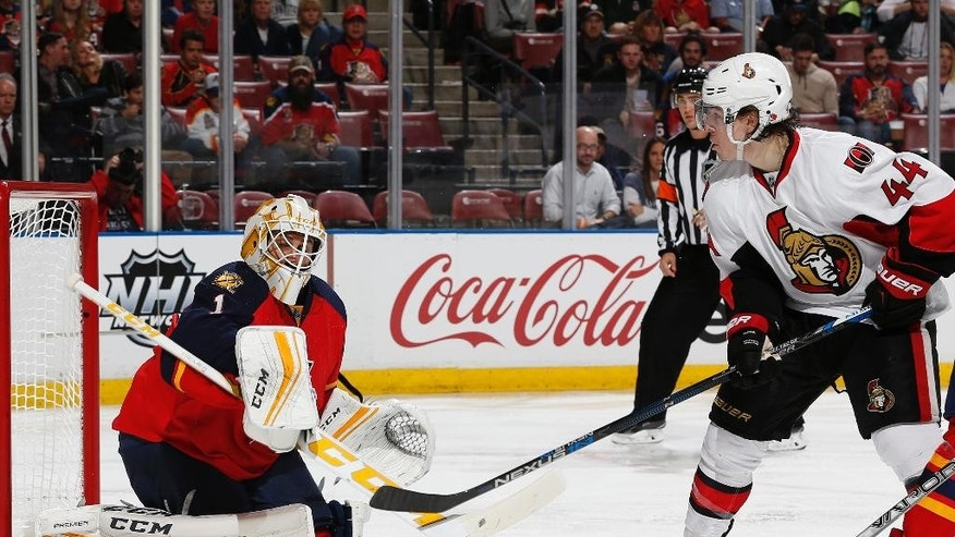 Florida Panthers goaltender Roberto Luongo (1) deflects a shot by Ottawa Senators center Jean-Gabriel Pageau (44) during the second period of an NHL hockey game, Tuesday, Dec. 22, 2015, in Sunrise, Fla. (AP Photo/Joel Auerbach)