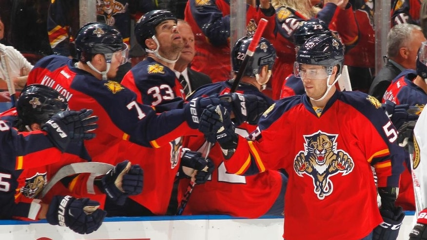 Florida Panthers forward Corban Knight (53) is congratulated by teammates after scoring a goal against the Ottawa Senators during the second period of an NHL hockey game Tuesday, Dec. 22, 2015, in Sunrise, Fla. (AP Photo/Joel Auerbach)