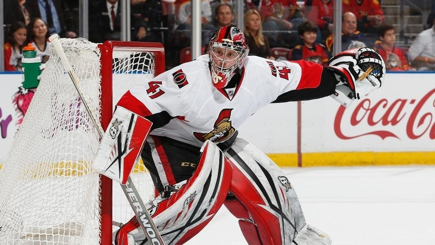 Ottawa Senators goaltender Craig Anderson defends the net against the Florida Panthers during the first period of an NHL hockey game Tuesday, Dec. 22, 2015, in Sunrise, Fla. (AP Photo/Joel Auerbach)