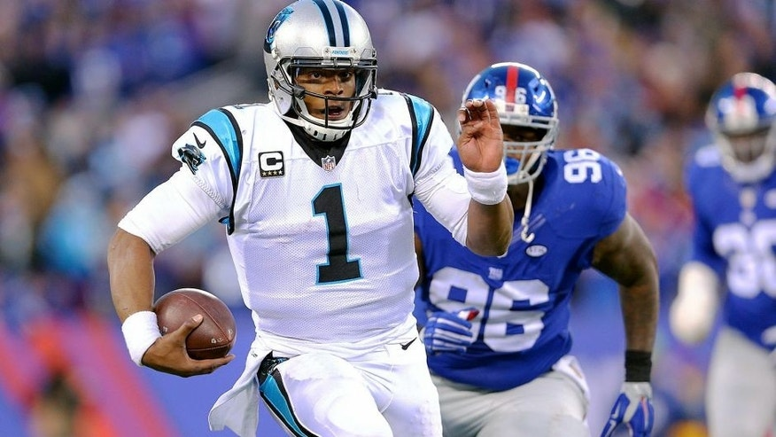 Dec 20, 2015; East Rutherford, NJ, USA; Carolina Panthers quarterback Cam Newton (1) runs with the ball against the New York Giants during the fourth quarter at MetLife Stadium. The Panthers defeated the Giants 38-35. Mandatory Credit: Brad Penner-USA TODAY Sports