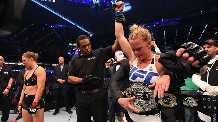 MELBOURNE, AUSTRALIA - NOVEMBER 15: Holly Holm of the United States celebrates after her knockout victory over Ronda Rousey of the United States in their UFC women's bantamweight championship bout during the UFC 193 event at Etihad Stadium on November 15, 2015 in Melbourne, Australia. (Photo by Josh Hedges/Zuffa LLC/Zuffa LLC via Getty Images)