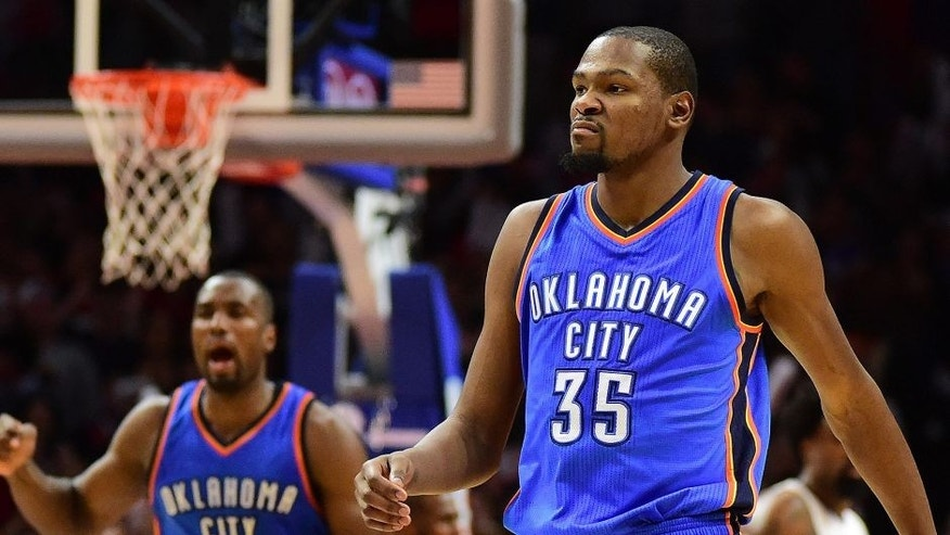 <p>LOS ANGELES, CA - DECEMBER 21: Kevin Durant #35 of the Oklahoma City Thunder reacts to his basket along with Serge Ibaka #9 in the final seconds of a 100-99 Thunder win over the Los Angeles Clippers at Staples Center on December 21, 2015 in Los Angeles, California. NOTE TO USER: User expressly acknowledges and agrees that, by downloading and or using this Photograph, user is consenting to the terms and condition of the Getty Images License Agreement. (Photo by Harry How/Getty Images)</p>