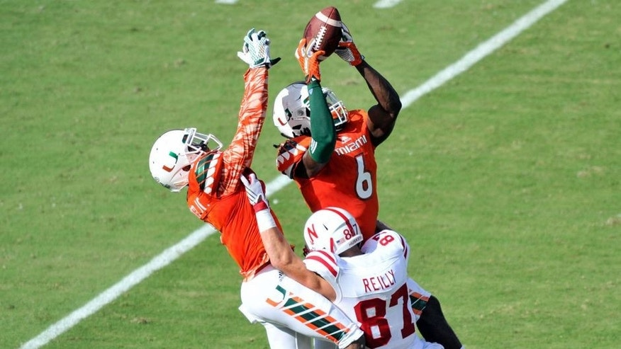 Sep 19, 2015; Miami Gardens, FL, USA; Miami Hurricanes defensive back Jamal Carter (6) is unable to make a catch that was intended for Nebraska Cornhuskers wide receiver Brandon Reilly (87) during the first half at Sun Life Stadium. Mandatory Credit: Steve Mitchell-USA TODAY Sports