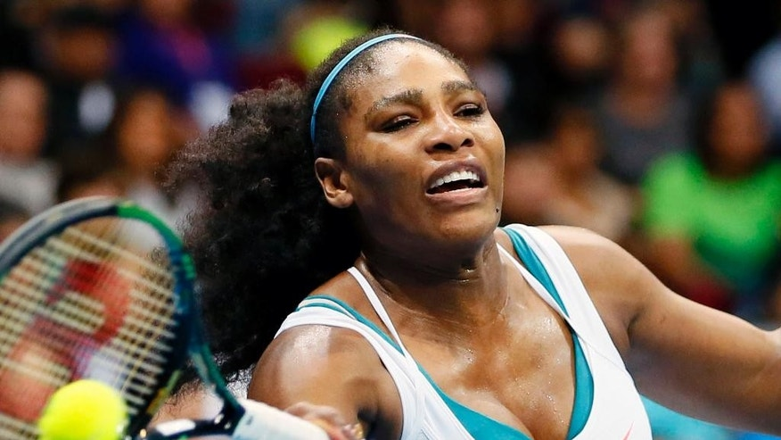 FILE - In this Tuesday, Dec. 8, 2015 file photo, Serena Williams of the Philippine Mavericks returns a shot to Australia's Samantha Stosur of the Indian Aces during the women's singles in the  2015 International Premier Tennis League at the Mall of Asia Arena at suburban Pasay city south of Manila, Philippines. Serena Williams was all set to put an emphatic capper on her remarkable career. After winning the first three majors of the year, she reached the semifinals of the U.S. Open on the cusp of the first tennis Grand Slam in nearly three decades. The only two players standing in her way were a pair of unheralded Italians. But Williams was stunned in the semifinals by 43rd-ranked Roberta Vinci, which left us all feeling a bit like Drake when that hotline don't bling anymore. (AP Photo/Bullit Marquez, File)