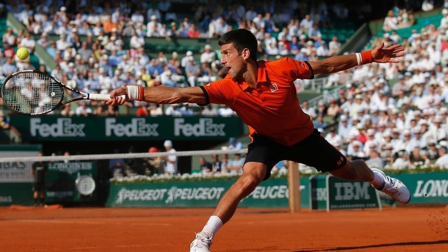 FILE - In this June 5, 2015 file photo Serbia's Novak Djokovic stretches to return the ball to Britain's Andy Murray, right, during their semifinal match of the French Open tennis tournament at the Roland Garros stadium in Paris, France. (AP Photo/Francois Mori, file)