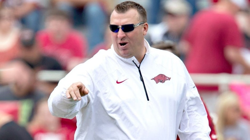 FAYETTEVILLE, ARKANSAS - APRIL 26: Head Coach Bret Bielema of the Arkansas Razorbacks watches his team warm up before the Red White Spring Football game at Razorback Stadium on April 26, 2014 in Fayetteville, Arkansas. (Photo by Wesley Hitt/Getty Images)