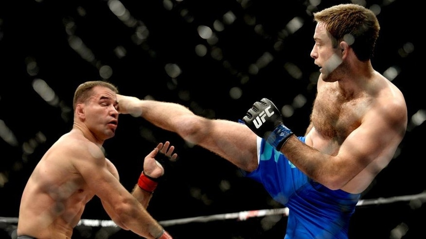 LAS VEGAS, NV - DECEMBER 11: (R-L) Ryan Hall kicks Artem Lobov in their lightweight finals bout during the TUF Finale event inside The Chelsea at The Cosmopolitan of Las Vegas on December 11, 2015 in Las Vegas, Nevada. (Photo by Brandon Magnus/Zuffa LLC/Zuffa LLC via Getty Images)