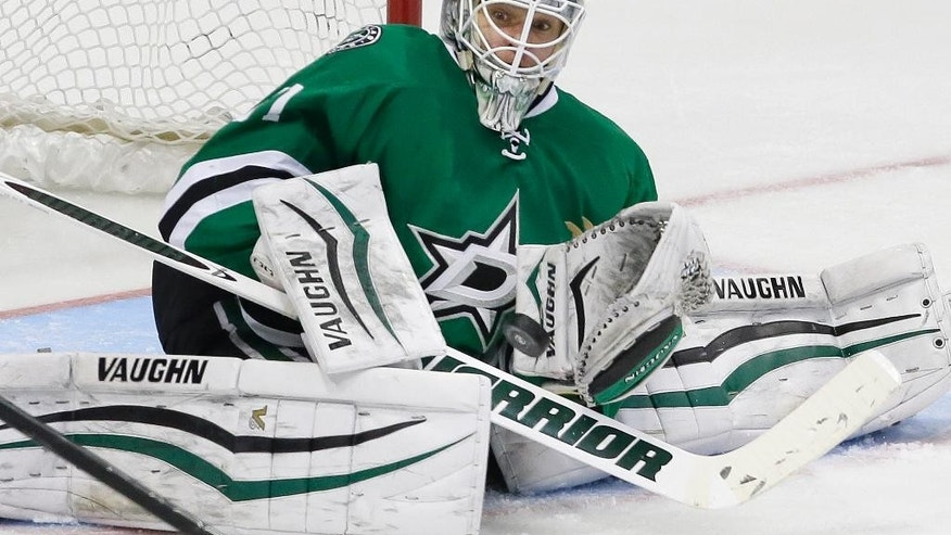 Dallas Stars goalie Antti Niemi watches the puck during the second period of an NHL hockey game against the Chicago Blackhawks on Tuesday, Dec. 22, 2015, in Dallas. (AP Photo/LM Otero)