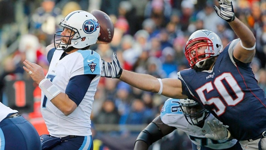 Dec 20, 2015; Foxborough, MA, USA; New England Patriots defensive end Rob Ninkovich (50) tries to get to the ball before Tennessee Titans quarterback Zach Mettenberger (7) throws a pass during the second half of the New England Patriots 33-16 win over the Tennessee Titans at Gillette Stadium. Mandatory Credit: Winslow Townson-USA TODAY Sports