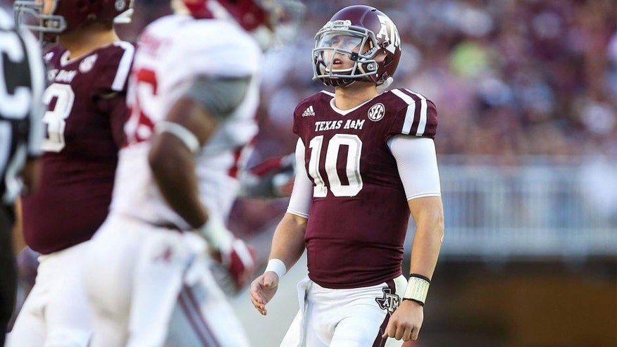 Oct 17, 2015; College Station, TX, USA; Texas A&M Aggies quarterback Kyle Allen (10) looks up after a play during the fourth quarter against the Alabama Crimson Tide at Kyle Field. The Crimson Tide defeated the Aggies 41-23. Mandatory Credit: Troy Taormina-USA TODAY Sports