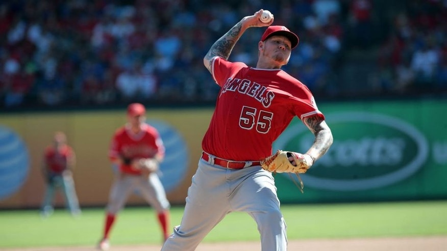 ARLINGTON, TX - OCTOBER 3: Mat Latos #55 of the Los Angeles Angels of Anaheim throws in the seventh inning against the Los A at Rangers Global Life Park in Arlington on October 3, 2015 in Arlington, Texas. (Photo by Rick Yeatts/Getty Images)