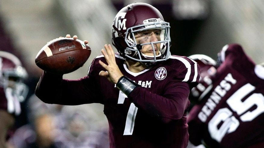 Nov 7, 2015; College Station, TX, USA; Texas A&M Aggies quarterback Jake Hubenak (7) looks for an open receiver during the fourth quarter against the Auburn Tigers at Kyle Field. The Tigers defeated the Aggies 26-10. Mandatory Credit: Troy Taormina-USA TODAY Sports