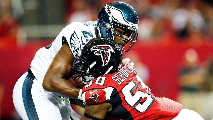 ATLANTA, GA - SEPTEMBER 14: O'Brien Schofield #50 of the Atlanta Falcons talkes DeMarco Murray #29 of the Philadelphia Eagles on a run play during the first half at the Georgia Dome on September 14, 2015 in Atlanta, Georgia. (Photo by Kevin C. Cox/Getty Images)
