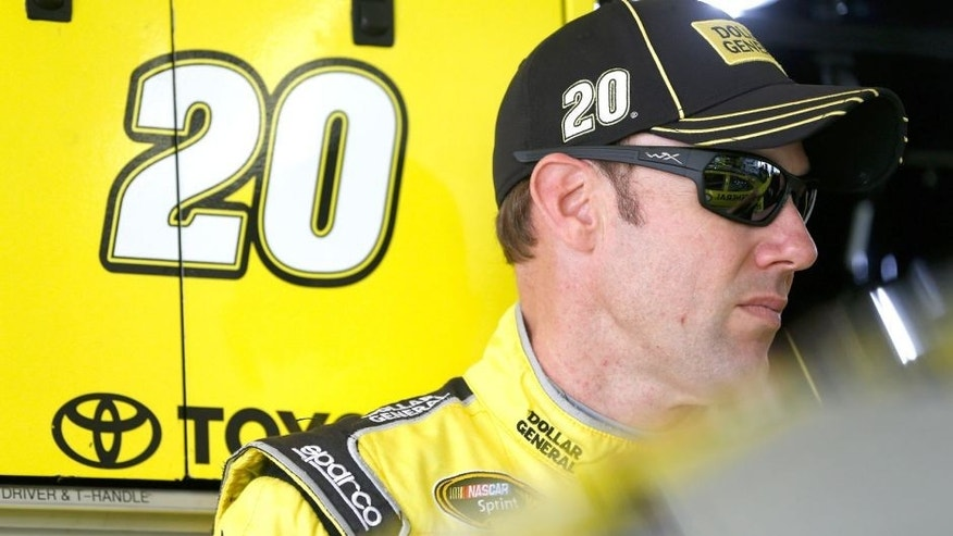 HOMESTEAD, FL - NOVEMBER 20: Matt Kenseth, driver of the #20 Dollar General Toyota, stands in the garage area during practice for the NASCAR Sprint Cup Series Ford EcoBoost 400 at Homestead-Miami Speedway on November 20, 2015 in Homestead, Florida. (Photo by Brian Lawdermilk/Getty Images)