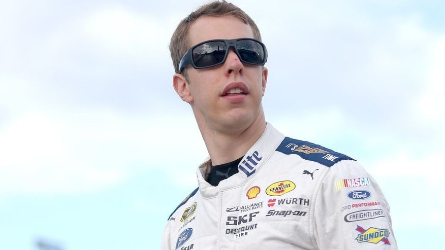 HOMESTEAD, FL - NOVEMBER 22: Brad Keselowski, driver of the #2 Miller Lite Ford, looks on prior to the NASCAR Sprint Cup Series Ford EcoBoost 400 at Homestead-Miami Speedway on November 22, 2015 in Homestead, Florida. (Photo by Sarah Crabill/Getty Images)