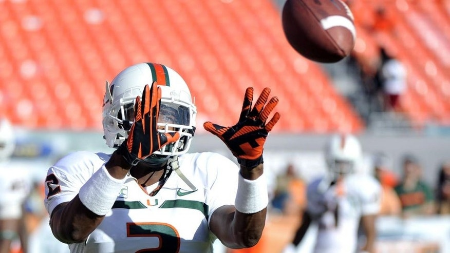 Apr 12, 2014; Miami, FL, USA; Miami Hurricanes defensive back Deon Bush (2) makes a catch prior to a spring game at Sun Life Stadium. Mandatory Credit: Steve Mitchell-USA TODAY Sports