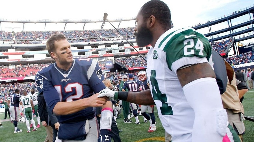 FOXBOROUGH, MA - OCTOBER 25: New England Patriots quarterback Tom Brady shakes hands with New York Jets Darrell Revis after the Patriots defeated the Jets 30-23 at Giillette Stadium on Sunday October 25, 2015. (Photo by Matthew J. Lee/The Boston Globe via Getty Images)