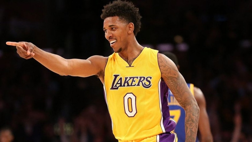 "<p style=""font-family: tahoma, arial, helvetica, sans-serif; font-size: 12px;"">LOS ANGELES, CA - DECEMBER 23: Nick Young #0 of the Los Angeles Lakers points to a teammate after making a three point shot against the Golden State Warriors at Staples Center on December 23, 2014 in Los Angeles, California. NOTE TO USER: User expressly acknowledges and agrees that, by downloading and or using this photograph, User is consenting to the terms and conditions of the Getty Images License Agreement. (Photo by Stephen Dunn/Getty Images)</p>"