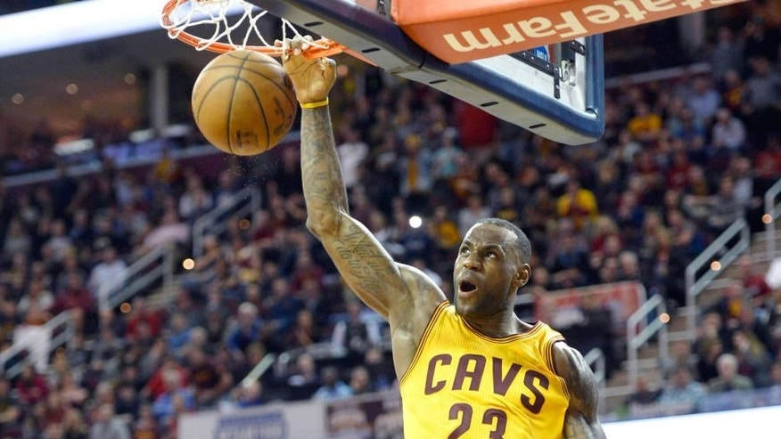 Dec 23, 2015; Cleveland, OH, USA; Cleveland Cavaliers forward LeBron James (23) dunks against the New York Knicks in the fourth quarter at Quicken Loans Arena. Mandatory Credit: David Richard-USA TODAY Sports