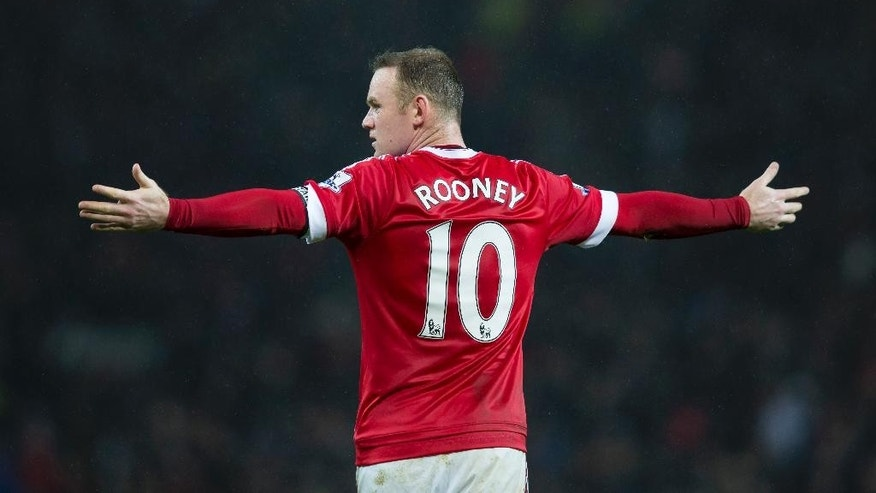 Manchester United's Wayne Rooney gestures during the English Premier League soccer match between Manchester United and Norwich City at Old Trafford Stadium, Manchester, England, Saturday, Dec. 19, 2015. (AP Photo/Jon Super)