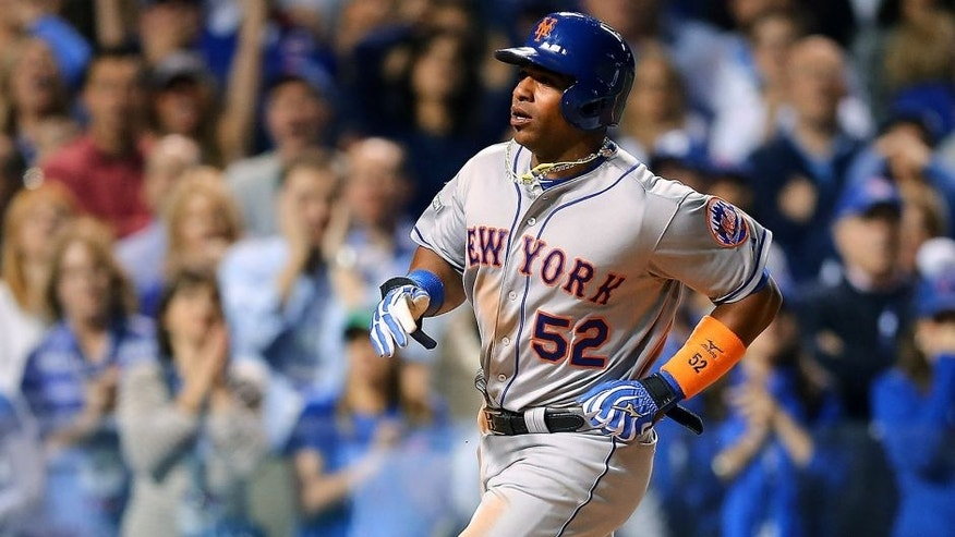 CHICAGO, IL - OCTOBER 20: Yoenis Cespedes #52 of the New York Mets scores a run off of a wild pitch thrown by Trevor Cahill #53 of the Chicago Cubs in the sixth inning during game three of the 2015 MLB National League Championship Series at Wrigley Field on October 20, 2015 in Chicago, Illinois. (Photo by Elsa/Getty Images)