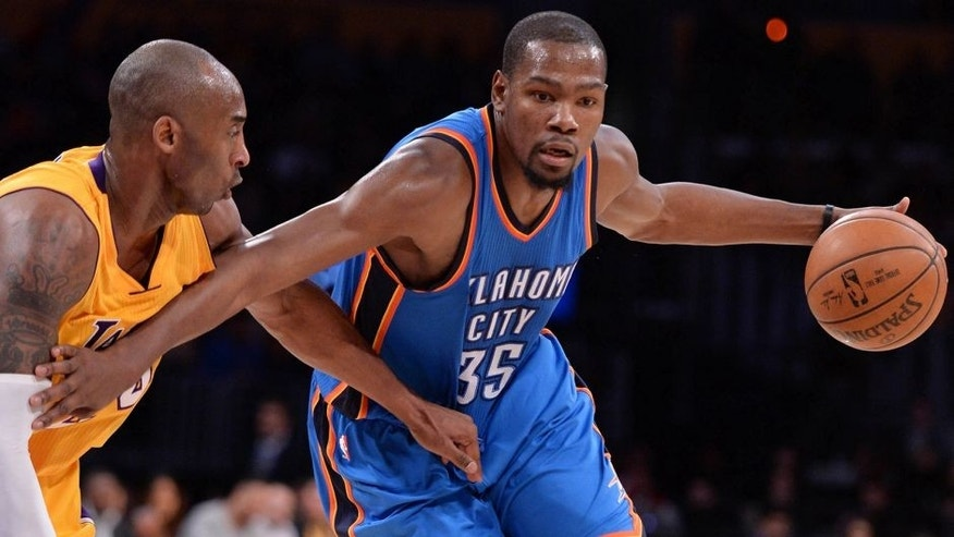 Dec 23, 2015; Los Angeles, CA, USA; Oklahoma City Thunder forward Kevin Durant (35) moves to the basket against Los Angeles Lakers forward Kobe Bryant (24) during the 2nd quarter at Staples Center. Mandatory Credit: Robert Hanashiro-USA TODAY Sports