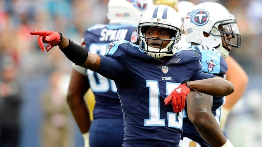 Dec 6, 2015; Nashville, TN, USA; Tennessee Titans receiver Kendall Wright (13) celebrates after a first down during the first half against the Jacksonville Jaguars at Nissan Stadium. Mandatory Credit: Christopher Hanewinckel-USA TODAY Sports