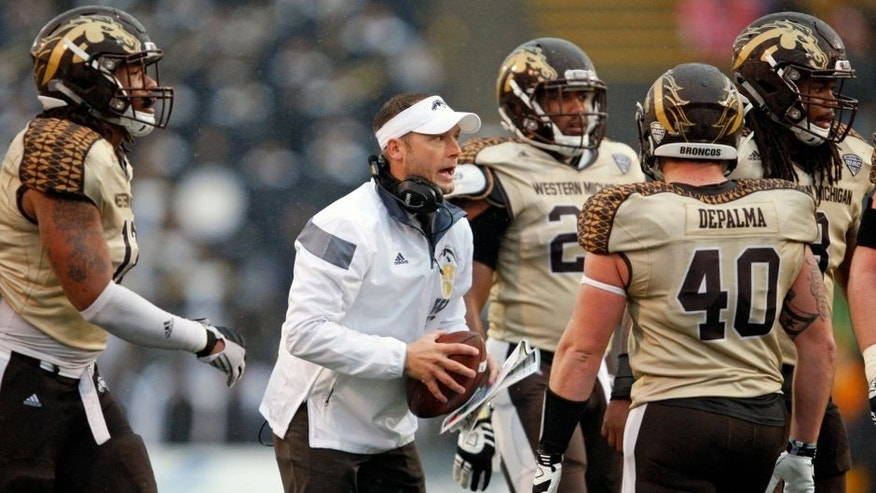 Nov 27, 2015; Toledo, OH, USA; Western Michigan Broncos head coach P.J. Fleck talks to players during the fourth quarter against the Toledo Rockets at Glass Bowl. Broncos win 35-30. Mandatory Credit: Raj Mehta-USA TODAY Sports