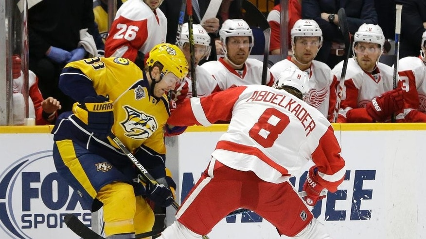 Nashville Predators center Colin Wilson (33) battles Detroit Red Wings left wing Justin Abdelkader (8) for the puck during the first period of an NHL hockey game Saturday, Dec. 26, 2015, in Nashville, Tenn. (AP Photo/Mark Humphrey)
