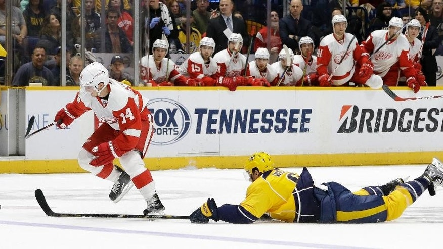 Nashville Predators defenseman Shea Weber (6) dives to slow down Detroit Red Wings center Gustav Nyquist (14), of Sweden, during the first period of an NHL hockey game Saturday, Dec. 26, 2015, in Nashville, Tenn. (AP Photo/Mark Humphrey)