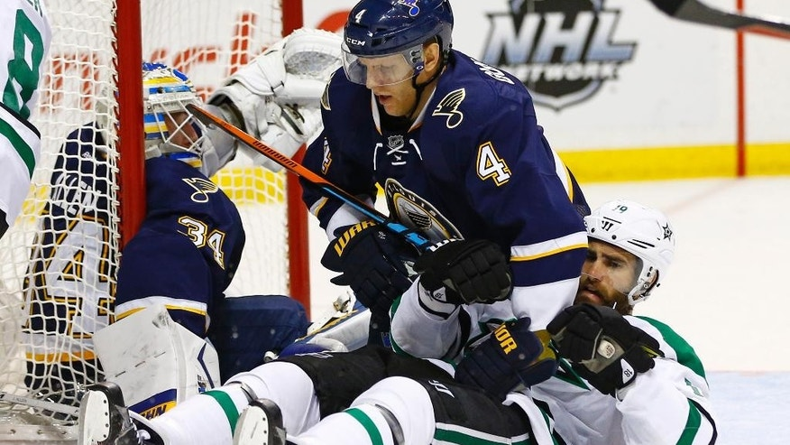 Dallas Stars' Patrick Eaves, bottom right, and St. Louis Blues' Carl Gunnarsson, of Sweden, lay on the ice after colliding with goalie Jake Allen during the second period of an NHL hockey game Saturday, Dec. 26, 2015, in St. Louis. (AP Photo/Billy Hurst)