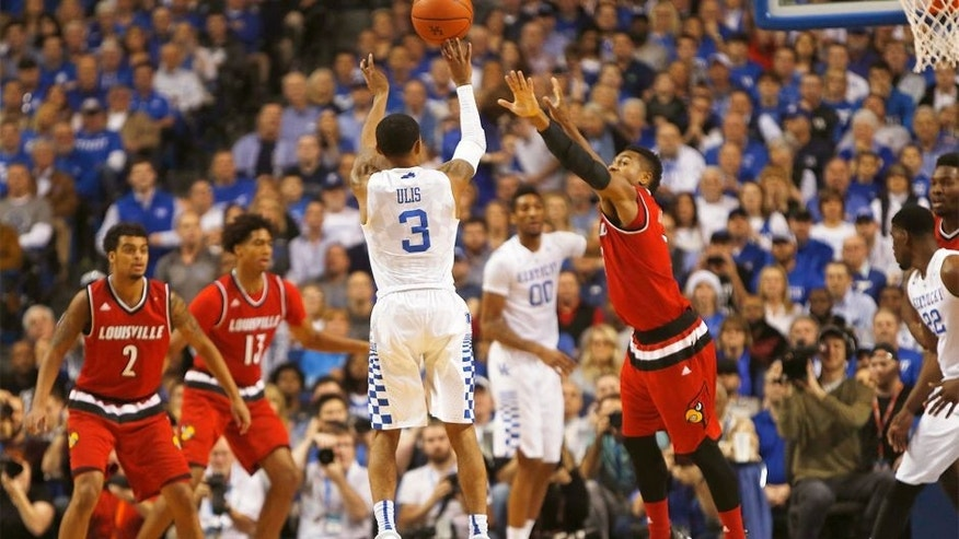 Dec 26, 2015; Lexington, KY, USA; Kentucky Wildcats guard Tyler Ulis (3) shoots during the first half against the Louisville Cardinals guard Trey Lewis (3) at Rupp Arena. Mandatory Credit: Frank Victores-USA TODAY Sports