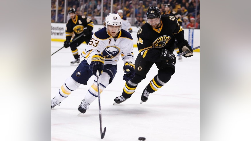 Boston Bruins' Dennis Seidenberg (44) defends against Buffalo Sabres' Tyler Ennis (63) during the first period of an NHL hockey game in Boston, Saturday, Dec. 26, 2015. (AP Photo/Michael Dwyer)