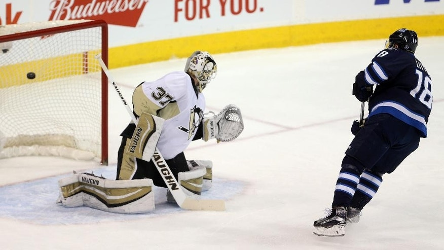 Winnipeg Jets' Bryan Little (18) scores on a penalty shot past Pittsburgh Penguins' goaltender Jeff Zatkoff (37) during the first period of an NHL hockey game in Winnipeg, Manitoba, Sunday, Dec. 27, 2015. (Trevor Hagan/The Canadian Press via AP) MANDATORY CREDIT