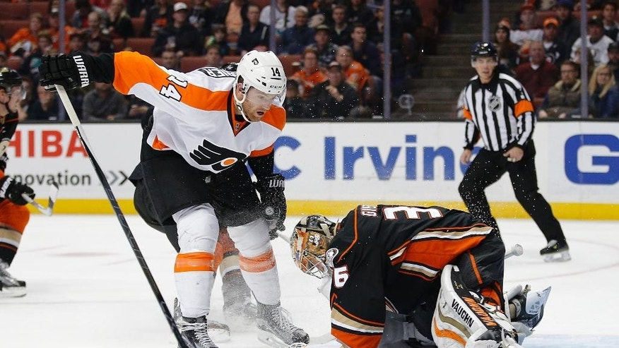Anaheim Ducks goalie John Gibson, right, stops a shot by Philadelphia Flyers' Sean Couturier during the first period of an NHL hockey game, Sunday, Dec. 27, 2015, in Anaheim, Calif. (AP Photo/Jae C. Hong)