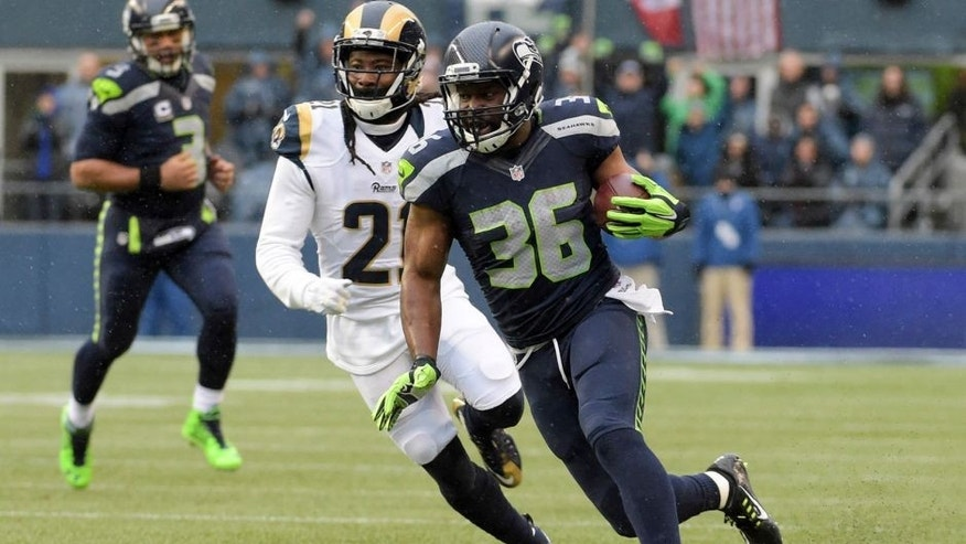 Dec 27, 2015; Seattle, WA, USA; Seattle Seahawks running back Bryce Brown (36) is defended by St. Louis Rams cornerback Trumaine Johnson (22) during an NFL football game at CenturyLink Field. Mandatory Credit: Kirby Lee-USA TODAY Sports