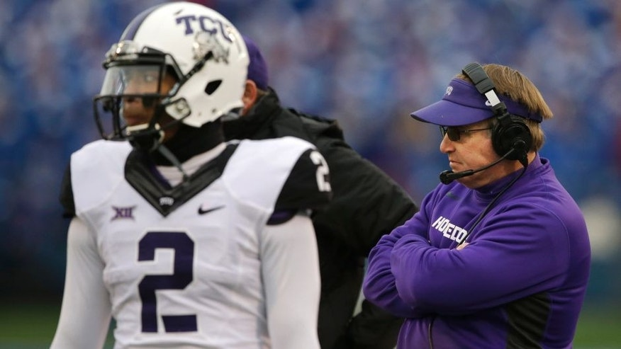 <p>TCU head coach Gary Patterson, right, and quarterback Trevone Boykin (2) stand on the side line during a play review in the first half of an NCAA college football game in Lawrence, Kan., Saturday, Nov. 15, 2014. (AP Photo/Orlin Wagner)</p>
