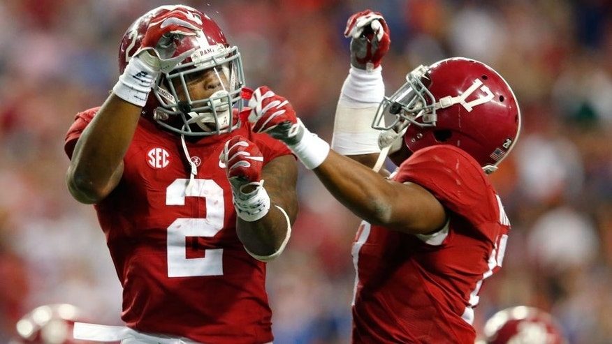 TLANTA, GA - DECEMBER 5: Running back Derrick Henry #2 of the Alabama Crimson Tide celebrates with running back Kenyan Drake #17 of the Alabama Crimson Tides after scoring a second quarter touchdown against the Florida Gators during the SEC Championship at the Georgia Dome on December 5, 2015 in Atlanta, Georgia. (Photo by Kevin C. Cox/Getty Images)