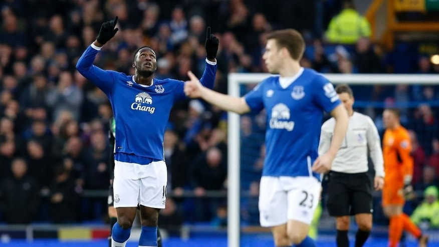 Everton's Romelu Lukaku , left, celebrates scoring his team's first goal of the match, during the English Premier League match between Everton and Stoke City, at Goodison Park, in  Liverpool, England, Monday Dec. 28, 2015.  (Peter Byrne/PA via AP) UNITED KINGDOM OUT