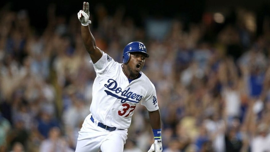 LOS ANGELES, CA - OCTOBER 01: Elian Herrera #37 of the Los Angeles Dodgers celebrates as he runs to first on his walk off RBI single in the ninth inning to defeat the San Francisco Giants on October 1, 2012 at Dodger Stadium in Los Angeles, California. The Dodgers won 3-2. (Photo by Stephen Dunn/Getty Images)