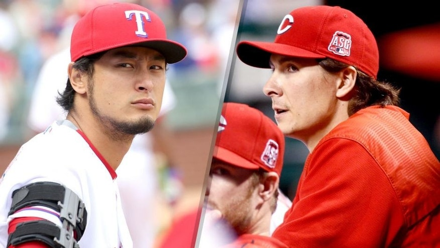<p>ARLINGTON, TX - APRIL 10: Yu Darvish #11 of the Texas Rangers looks on in the seventh inning of the home opener against the Houston Astros at Globe Life Park in Arlington on April 10, 2015 in Arlington, Texas. (Photo by Rick Yeatts/Getty Images)<br> <br> Aug 1, 2015; Cincinnati, OH, USA; Cincinnati Reds pitcher Homer Bailey watches from the dugout in the ninth inning against the Pittsburgh Pirates at Great American Ball Park. The Reds won 4-3. Mandatory Credit: David Kohl-USA TODAY Sports</p>