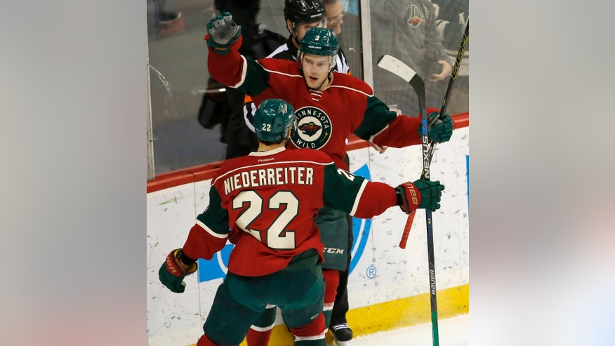 Minnesota Wild center Charlie Coyle (3) and right wing Nino Niederreiter (22), of Switzerland, celebrate Coyle's goal off Detroit Red Wings goalie Petr Mrazek during the first period of an NHL hockey game in St. Paul, Minn., Monday, Dec. 28, 2015. (AP Photo/Ann Heisenfelt)