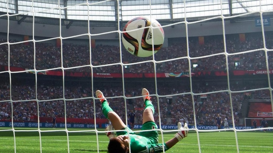 FILE - In this July 5, 2015, file photo, Japan goalkeeper Ayumi Kaihori is unable to stop a long distance shot for the third goal of the game by United States' Carli Lloyd during the first half of the FIFA Women's World Cup soccer championship in Vancouver, British Columbia, Canada. Lloyd scored three goals and the United States won 5-2. (Darryl Dyck/The Canadian Press via AP, File) MANDATORY CREDIT