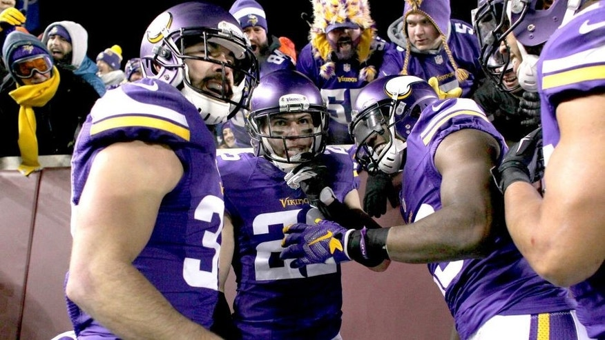 MINNEAPOLIS, MN - DECEMBER 27: Harrison Smith #22 of the Minnesota Vikings and teammates celebrate Smith's interception for a touchdown in the second quarter against the New York Giants on December 27, 2015 at TCF Bank Stadium in Minneapolis, Minnesota. (Photo by Adam Bettcher/Getty Images)