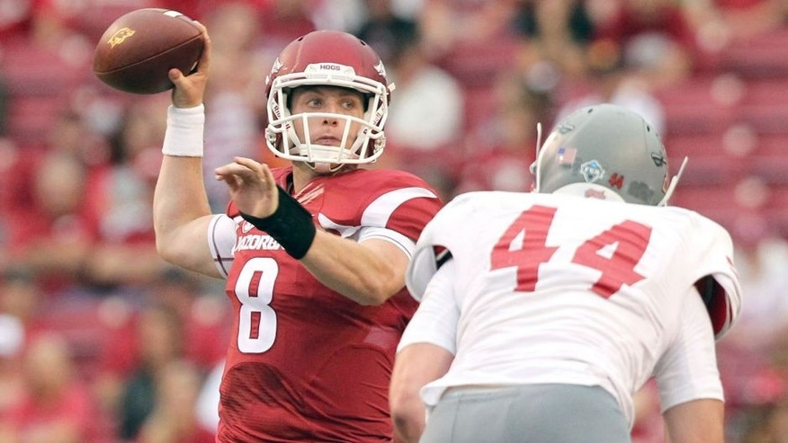 Sep 6, 2014; Fayetteville, AR, USA; Arkansas Razorbacks quarterback Austin Allen (8) looks to pass defended by Nicholls State Colonels linebacker John Williamson (44) at Donald W. Reynolds Razorback Stadium. Arkansas defeated Nicholls State 73-7. Mandatory Credit: Nelson Chenault-USA TODAY Sports