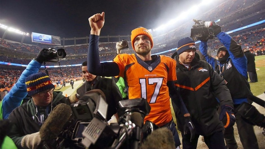 Dec 28, 2015; Denver, CO, USA; Denver Broncos quarterback Brock Osweiler (17) celebrates after the game against the Cincinnati Bengals at Sports Authority Field at Mile High. The Broncos won 20-17 in overtime. Mandatory Credit: Chris Humphreys-USA TODAY Sports