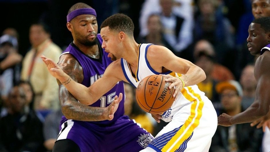 OAKLAND, CA - DECEMBER 28: Stephen Curry #30 of the Golden State Warriors tries to dribble around DeMarcus Cousins #15 of the Sacramento Kings at ORACLE Arena on December 28, 2015 in Oakland, California. NOTE TO USER: User expressly acknowledges and agrees that, by downloading and or using this photograph, User is consenting to the terms and conditions of the Getty Images License Agreement. (Photo by Ezra Shaw/Getty Images)