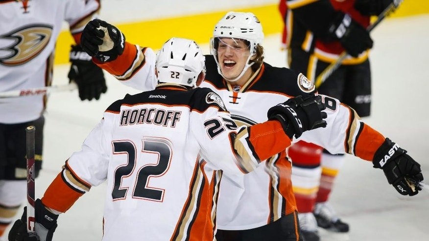 Anaheim Ducks' Shawn Horcoff, left, celebrates his goal with teammate Rickard Rakell, of Sweden, during the second period of an NHL hockey game against the Calgary Flames in Calgary, Alberta, Tuesday, Dec. 29, 2015. (Jeff McIntosh/The Canadian Press via AP) MANDATORY CREDIT